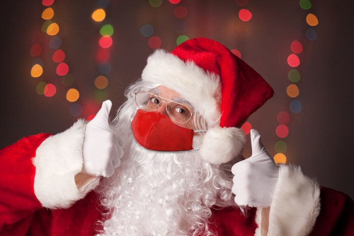 Santa is masked up and ready to deliver gifts this Christmas