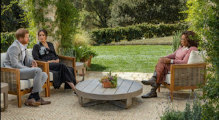 The Duke and Duchess of Sussex sit down with Oprah in a peaceful garden. Photo Courtesy of BBC.