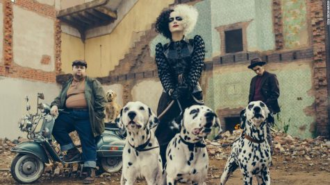 Cruella De Vil stands with her Dalmatians and evil henchmen. Photo courtesy of CNN.
