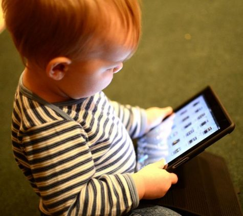 This baby is being entertained by its parents iPad Photo Credit: physiciansnews.com